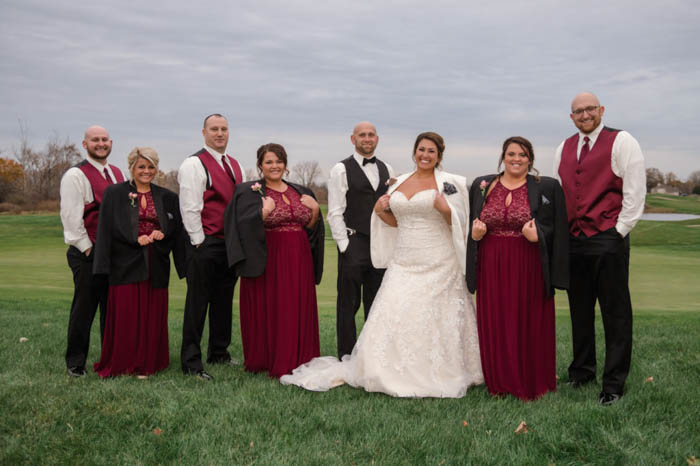 bridesmaids and bride wearing the groomsmen and groom