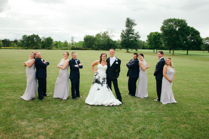 variety of the classical bridal party pose, with bridesmaids and groomsmen paired off around the bride and groom