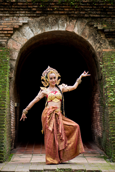 Photo of a Thai Dancer standing in front of a tunnel - How to Create a Black Background For Photography