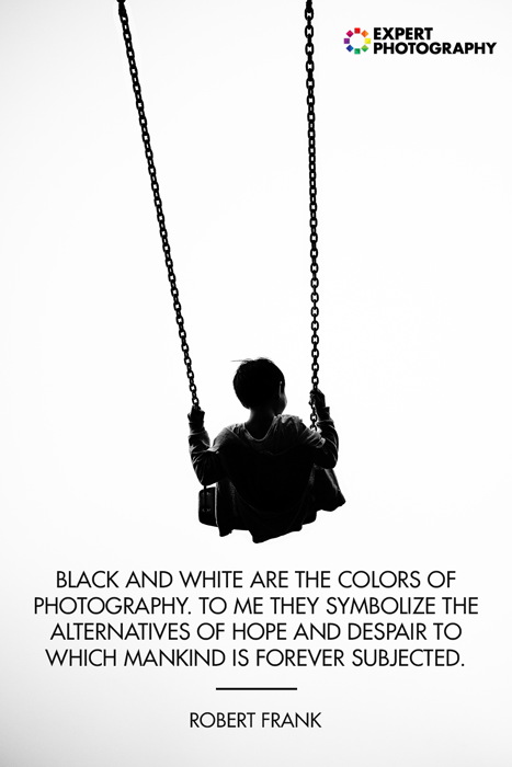A photo of the silhouette of a little boy on a swingset overlayed with a black and white photography quote from Robert Frank