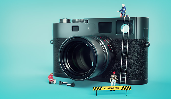A camera with miniature figurines around it