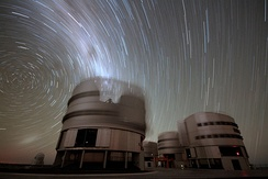 In this 45-minute exposure taken on a dark clear night at Paranal Observatory, the stars leave trails as they appear to revolve around the south celestial pole (left), due to Earth