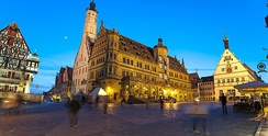 Blue Hour on the central square in Rothenburg ob der Tauber, Germany. Notice how a long exposure blurs passerby while buildings retain sharp focus