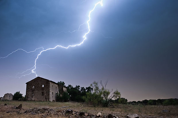 Lightning striking a house